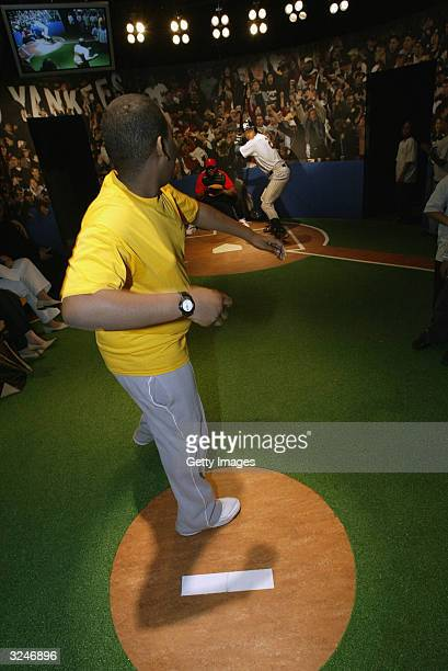 Brandon Connell a member of the Gloria Wise Boys And Girls Club throws a pitch at the launch of a new interactive experience featuring a figure of...