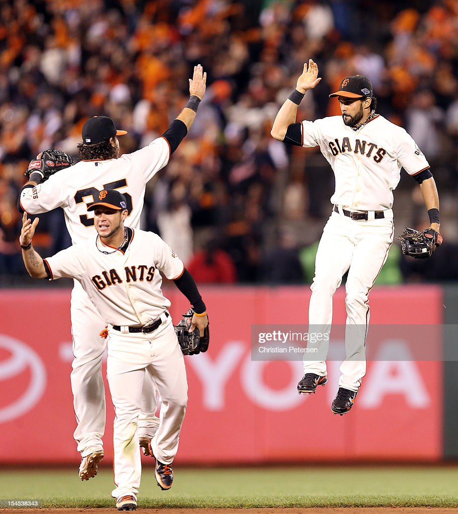 Brandon Crawford #35 and (R) Angel Pagan #16 of the San Francisco Giants celebrate the Giants 6-1 victory against the St. Louis Cardinals in Game Six of the National League Championship Series at AT&T Park on October 21, 2012 in San Francisco, California.