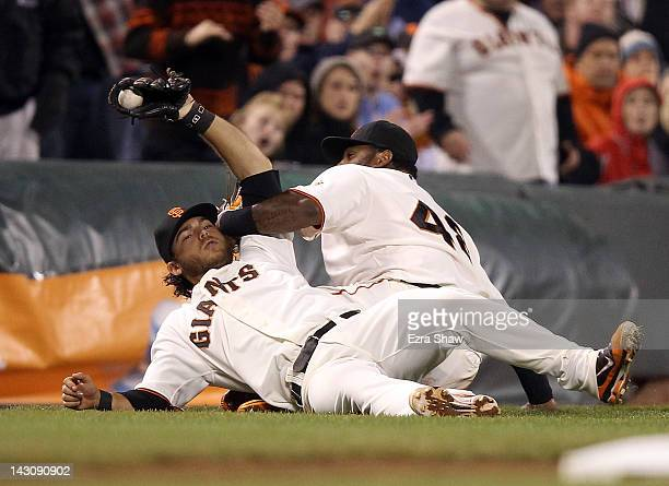 Brandon Crawford and Pablo Sandoval of the San Francisco Giants collide when Crawford caught a ball hit by Jimmy Rollins of the Philadelphia Phillies...