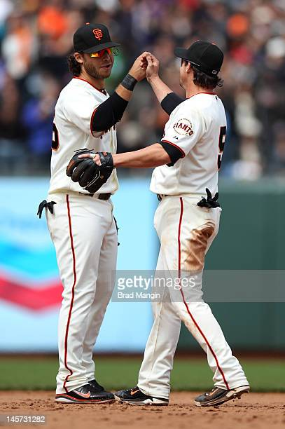 Brandon Crawford and Ryan Theriot of the San Francisco Giants celebrate after the game against the Chicago Cubs at ATT Park on Monday June 4 2012 in...