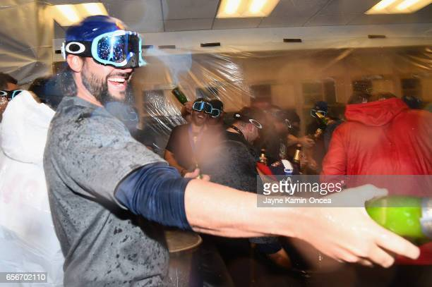 Brandon Crawford of team United States celebrates in the locker room after their 80 win over Puerto Rico during Game 3 of the Championship Round of...