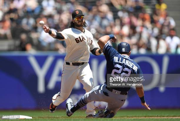 Andrew McCutchen of the San Francisco Giants reacts after he was hit by a pitch from Phil Maton of the San Diego Padres in the bottom of the seventh...