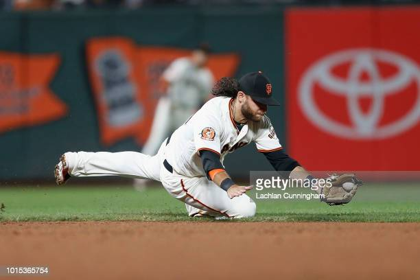 Brandon Crawford of the San Francisco Giants fields a ball hit by Elias Diaz of the Pittsburgh Pirates in the ninth inning at ATT Park on August 11...