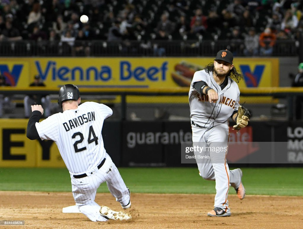 Brandon Crawford #35 of the San Francisco Giants forces out Matt Davidson #24 of the Chicago White Sox at second base during the second inning on September 8, 2017 at Guaranteed Rate Field in Chicago, Illinois.