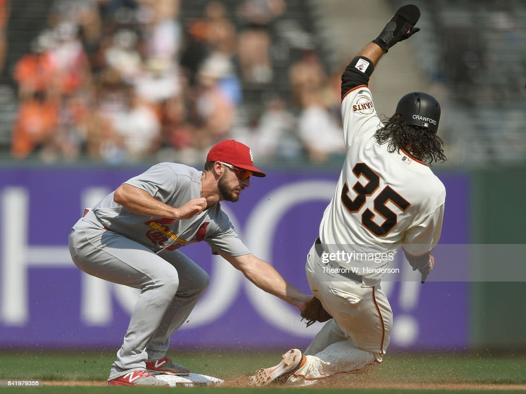 Brandon Crawford #35 of the San Francisco Giants gets caught stealling tagged out by Paul DeJong #11 of the St. Louis Cardinals in the bottom of the seventh inning at AT&T Park on September 2, 2017 in San Francisco, California.
