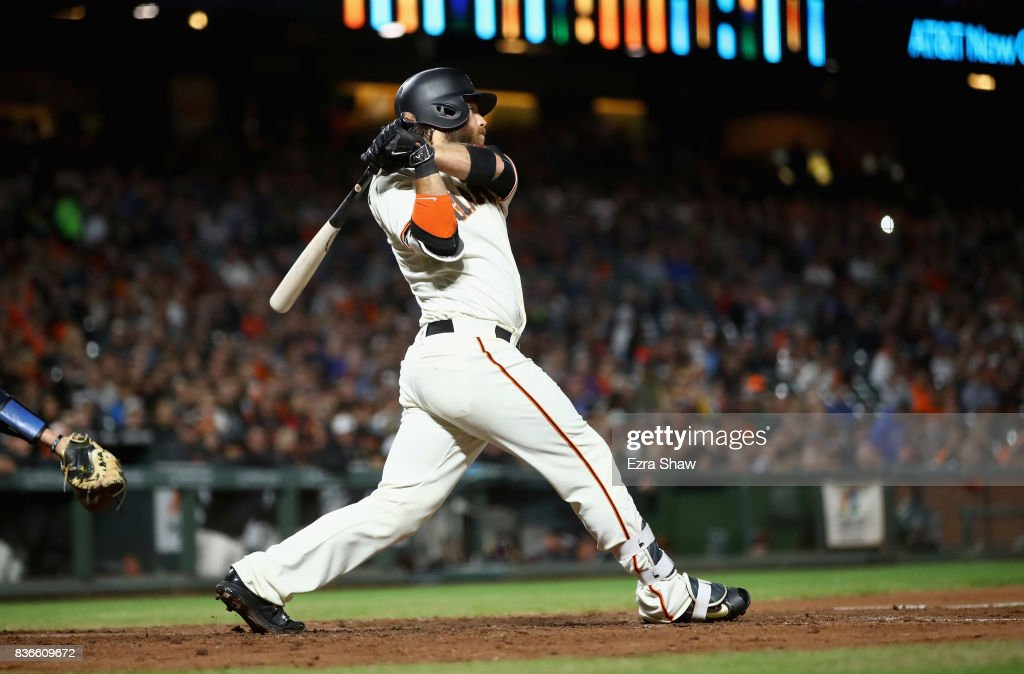Brandon Crawford #35 of the San Francisco Giants hits a double that scored a run in the fourth inning against the Milwaukee Brewers at AT&T Park on August 21, 2017 in San Francisco, California.