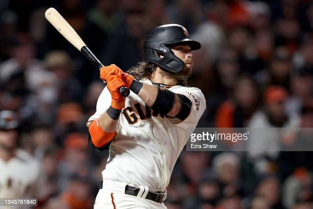 Brandon Crawford of the San Francisco Giants hits an RBI single in the sixth inning against the Los Angeles Dodgers during Game 2 of the National...