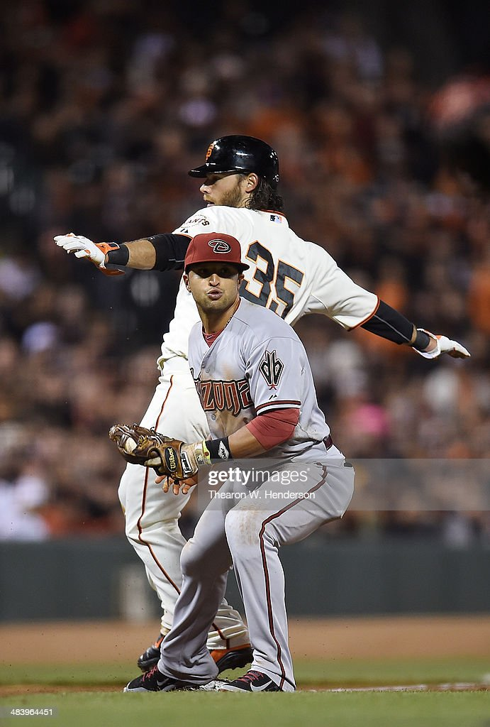Brandon Crawford #35 of the San Francisco Giants is out on a fielder's choice at third base by Martin Prado #14 of the Arizona Diamondbacks in the bottom of the fourth inning at AT&T Park on April 10, 2014 in San Francisco, California.