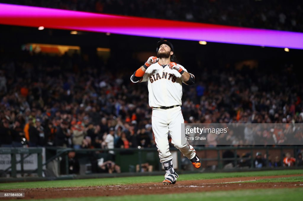 Brandon Crawford #35 of the San Francisco Giants looks up as he crosses home plate after hitting a two-run home run in the fifth inning against the Milwaukee Brewers at AT&T Park on August 22, 2017 in San Francisco, California.