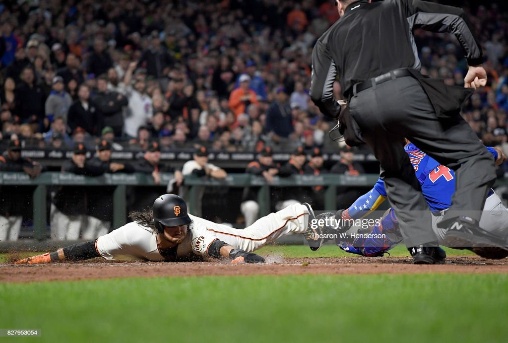 Brandon Crawford #35 of the San Francisco Giants scores sliding around the tag of Willson Contreras #40 of the Chicago Cubs in the bottom of the fourth inning at AT&T Park on August 8, 2017 in San Francisco, California.