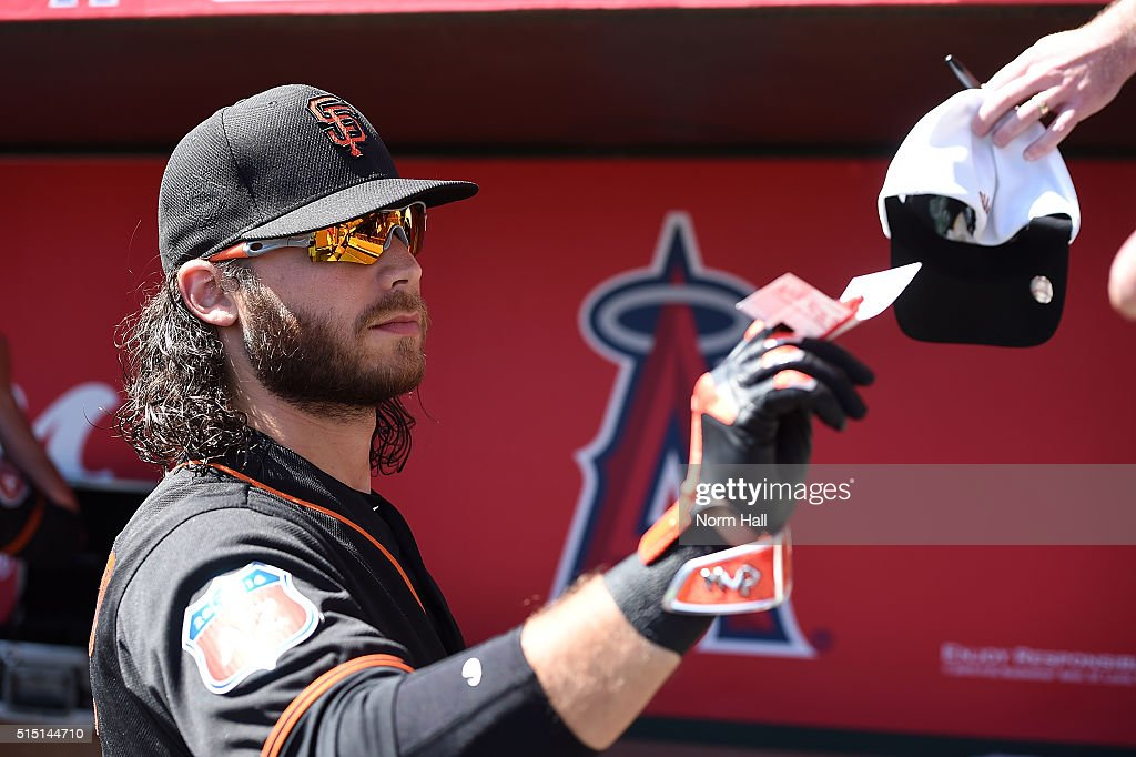 Brandon Crawford #35 of the San Francisco Giants signs some autographs prior to a game against the Los Angeles Angels of Anaheim at Tempe Diablo Stadium on March 12, 2016 in Tempe, Arizona.