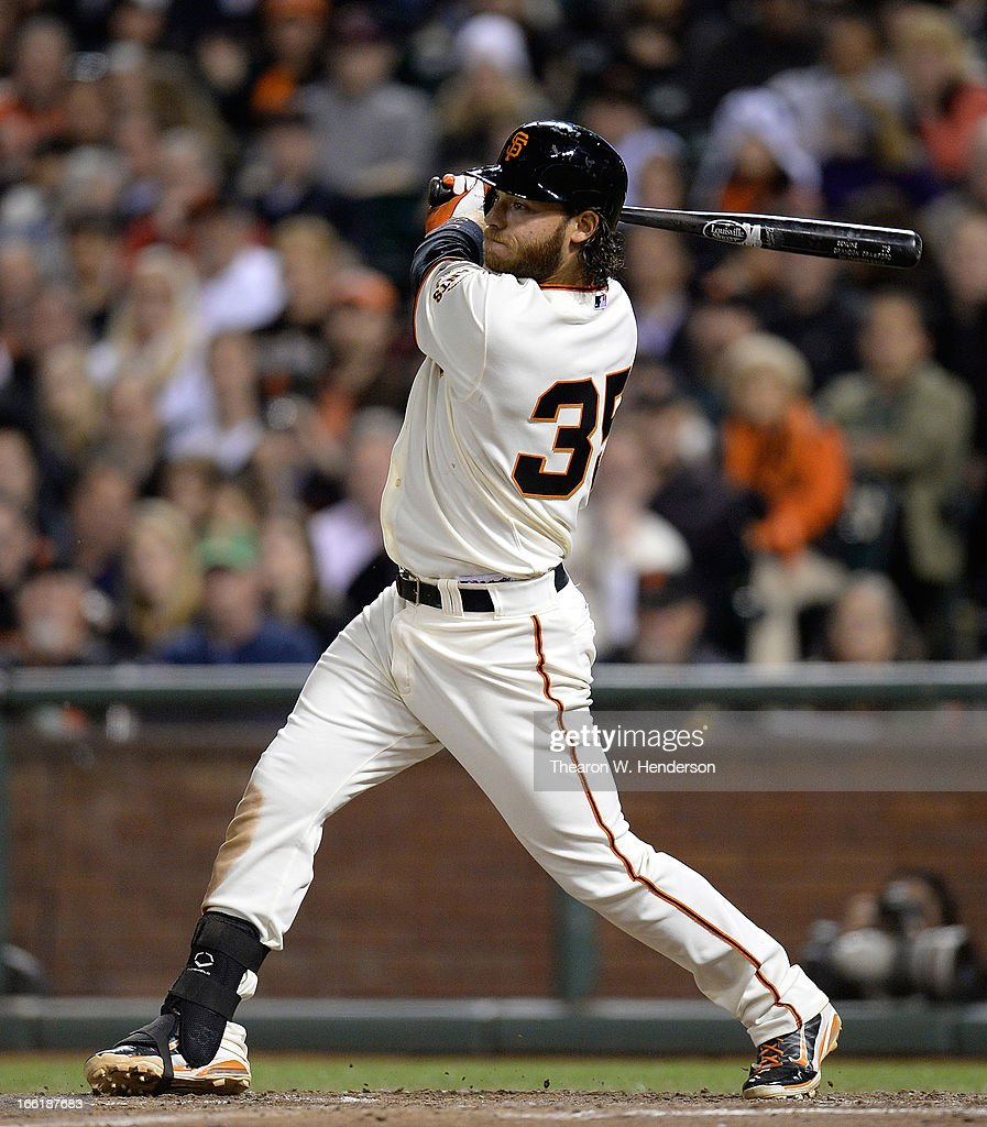 Brandon Crawford #35 of the San Francisco Giants swings and watches the flight of his ball as he hits a three-run home run against the Colorado Rockies in the six inning at AT&T Park on April 9, 2013 in San Francisco, California.