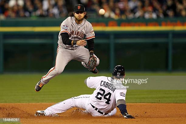 Brandon Crawford of the San Francisco Giants tags out Miguel Cabrera of the Detroit Tigers for a double play to end the first inning during Game...