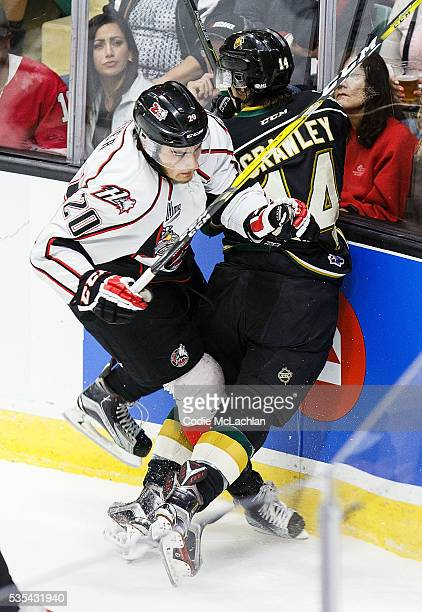 Brandon Crawley of the London Knights collides with Timo Meier of the Rouyn-Noranda Huskies during the Memorial Cup Final on May 29, 2016 at the...