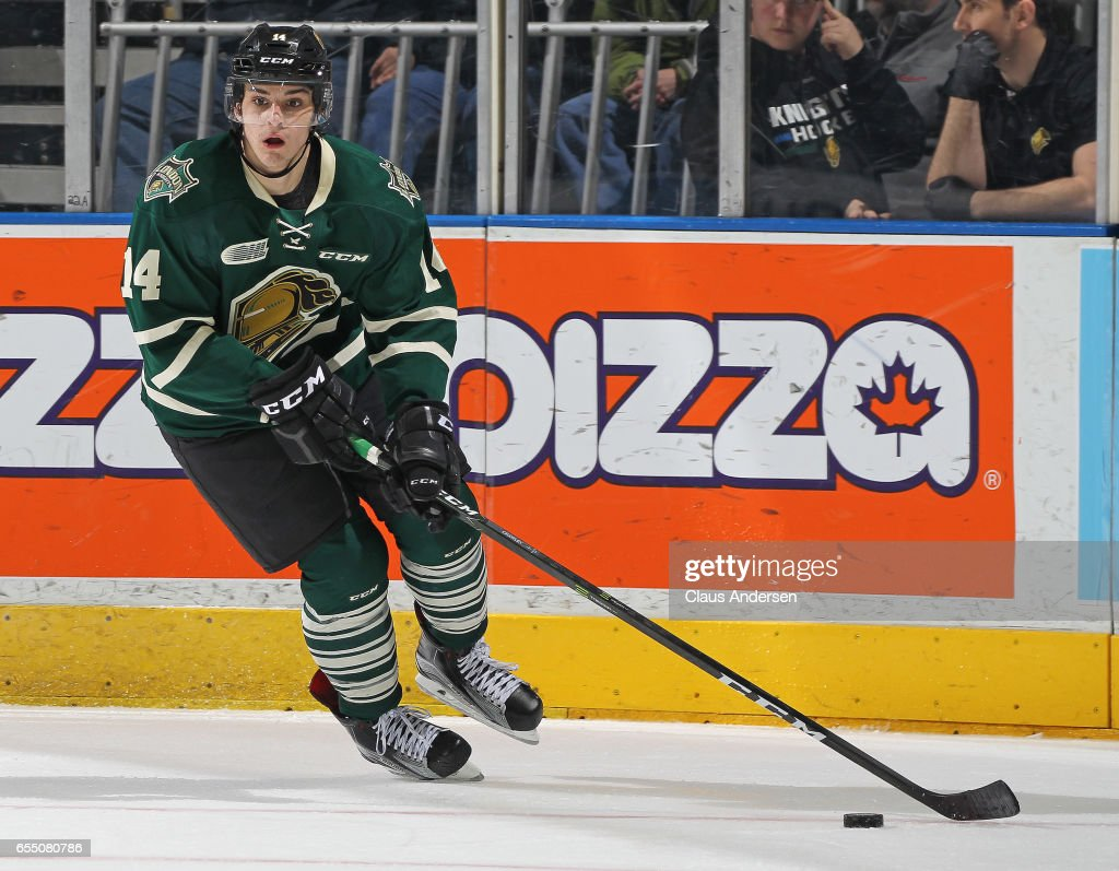 Brandon Crawley #14 of the London Knights skates with the puck against the Flint Firebirds during an OHL game at Budweiser Gardens on March 17, 2017 in London, Ontario, Canada. The Knights defeated the Firebirds 7-3.