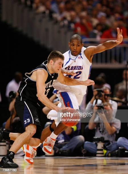 Brandon Crone of the Butler Bulldogs dribbles around Al Horford of the Florida Gators during the midwest regionals of the NCAA Men's Basketball...