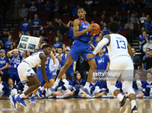 Brandon Cyrus of the DePaul Blue Demons in action against Myles Cale and Myles Powell of the Seton Hall Pirates during a game at Prudential Center on...