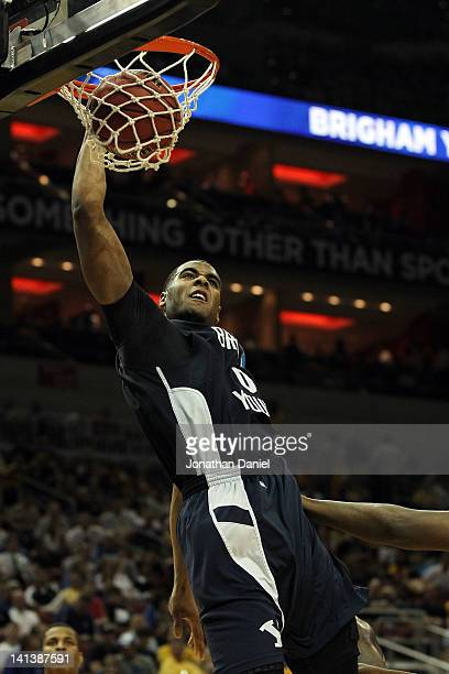Brandon Davies of the Brigham Young Cougars dunks the ball against the Marquette Golden Eagles during the second round of the 2012 NCAA Men's...