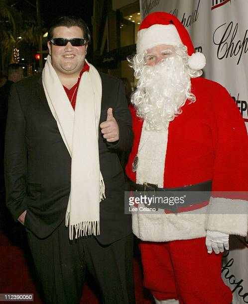 Brandon Davis and Santa Claus during Jason Davis Chopard and The Hollywood Reporter Celebrate the Holidays with a Shopping Party to Benefit The Nancy...
