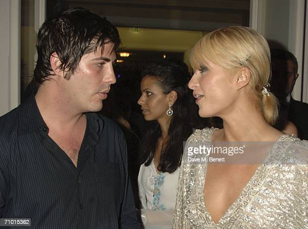 Brandon Davis and socialite Paris Hilton attends the annual De Grisogono party hosted by the Swissbased jewellery house at Hotel Du Cap on May 22...