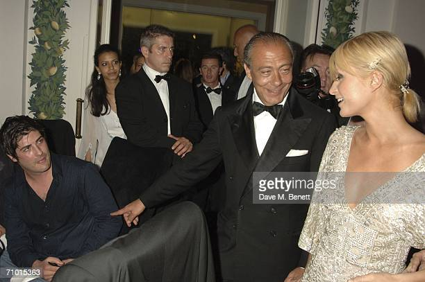 Brandon Davis Fawaz Gruosi and socialite Paris Hilton attends the annual De Grisogono party hosted by the Swissbased jewellery house at Hotel Du Cap...
