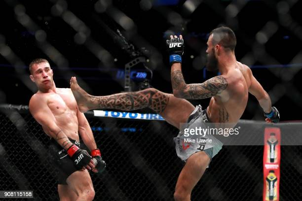 Brandon Davis kicks against Kyle Bochniak in their Featherweight fight during UFC 220 at TD Garden on January 20 2018 in Boston Massachusetts