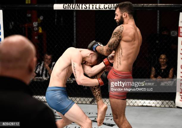 Brandon Davis knees Austin Arnett in their featherweight bout during Dana White's Tuesday Night Contender Series at the TUF Gym on August 1 2017 in...