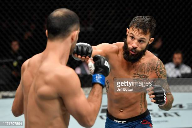 Brandon Davis punches Giga Chikadze of Georgia in their featherweight bout during the UFC Fight Night event at Royal Arena on September 28 2019 in...