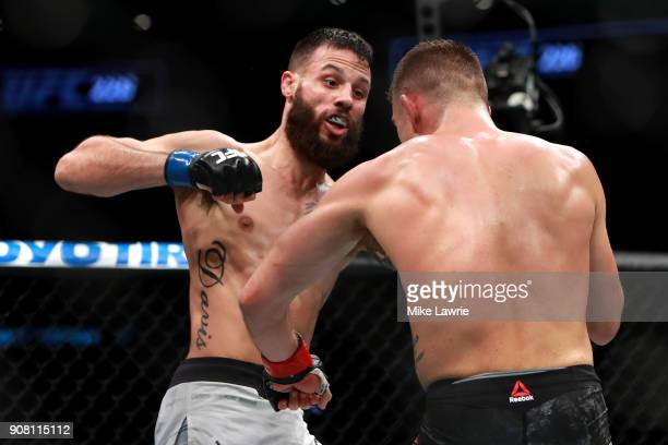Brandon Davis throws a punch against Kyle Bochniak in their Featherweight fight during UFC 220 at TD Garden on January 20 2018 in Boston Massachusetts