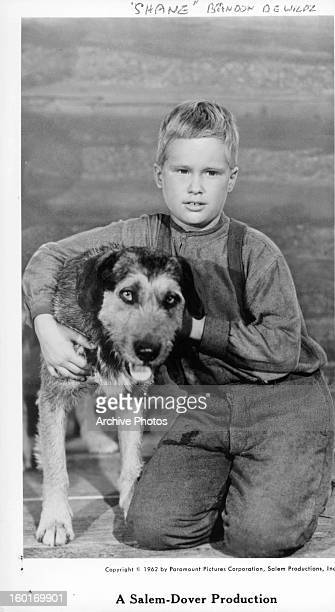 Brandon De Wilde with dog in publicity portrait for the film 'Shane' 1953