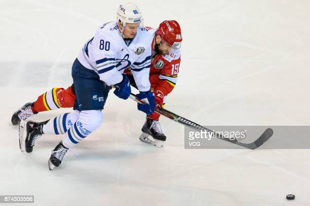 Brandon DeFazio of HC Kunlun Red Star and Dmitri Sidlyarov of HC Dynamo Moscow vie for the puck during the 2017/18 Kontinental Hockey League Regular...