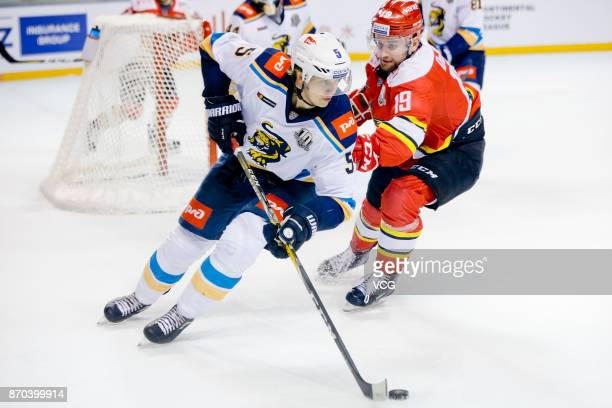 Brandon DeFazio of HC Kunlun Red Star and Jyrki Jokipakka of HC Sochi battle for the puck in the 2017/18 Kontinental Hockey League Regular Season...