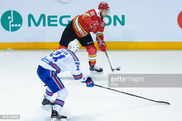 Brandon DeFazio of HC Kunlun Red Star and Sergei Kalinin of SKA Saint Petersburg vie for the puck during the 2017/18 Kontinental Hockey League...