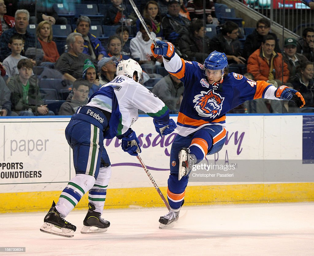 Brandon DeFazio #42 of the Bridgeport Sound Tigers is checked by Sean Collins #25 of the Connecticut Whale during an American Hockey League game on December 26, 2012 at the Webster Bank Arena at Harbor Yard in Bridgeport, Connecticut.