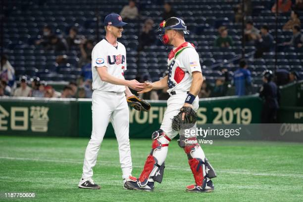 Brandon Dickson of Team USA celebrates with teamate during the WBSC Premier 12 Super Round game between USA and Chinese Taipei at the Tokyo Dome on...
