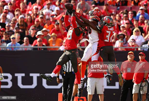 Brandon Dixon of the Tampa Bay Buccaneers catches an interception over AJ Green of the Cincinnati Bengals during a game at Raymond James Stadium on...