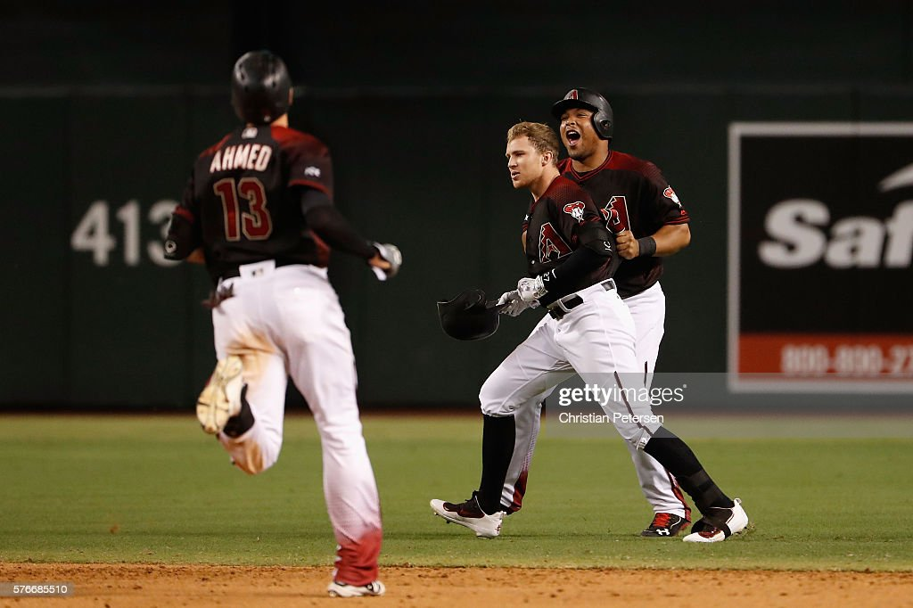 Brandon Drury #27 of the Arizona Diamondbacks celebrates with Nick Ahmed #13 and Yasmany Tomas #24 after a walk off single against the Los Angeles Dodgers during the12th inning of the MLB game at Chase Field on August 16, 2016 in Phoenix, Arizona.