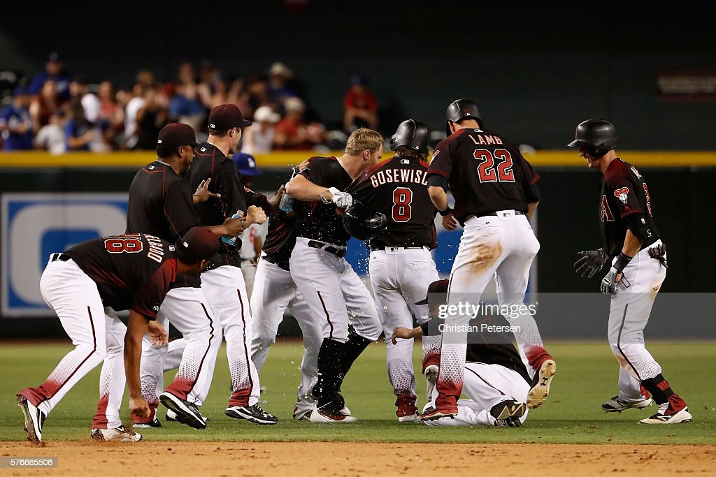 Brandon Drury (C) of the Arizona Diamondbacks celebrates with teammates after a walk off single against the Los Angeles Dodgers during the12th inning of the MLB game at Chase Field on August 16, 2016 in Phoenix, Arizona.