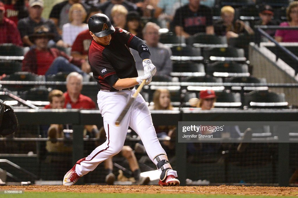 Brandon Drury #27 of the Arizona Diamondbacks hits a two run home run against the Colorado Rockies during the sixth inning at Chase Field on April 30, 2016 in Phoenix, Arizona.