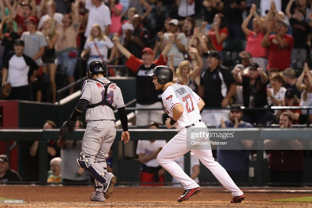 Brandon Drury #27 of the Arizona Diamondbacks reacts after scoring the game winning run against the Colorado Rockies during the ninth inning of the MLB game at Chase Field on July 2, 2017 in Phoenix, Arizona. The Diamondbacks defeated the Rockies 4-3.