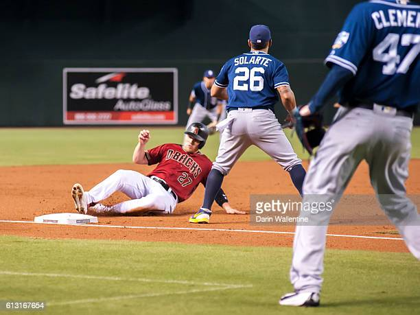 Brandon Drury of the Arizona Diamondbacks slides safely into third base on a single by Yasmany Tomas in the second inning of the MLB game against the...