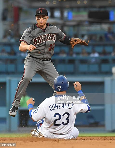 Brandon Drury of the Arizona Diamondbacks throws to first as Adrian Gonzalez of the Los Angeles Dodgers is out on a double play in the fourth inning...