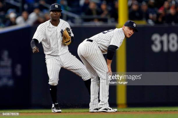 Brandon Drury of the New York Yankees and Didi Gregorius of the New York Yankees in action against the Baltimore Orioles during the fifth inning at...