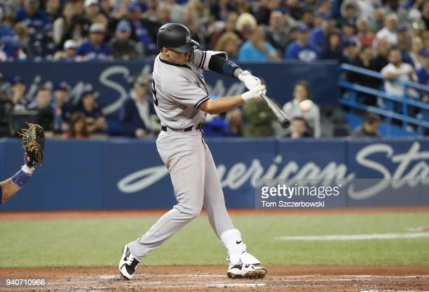Brandon Drury of the New York Yankees hits a tworun home run in the third inning during MLB game action against the Toronto Blue Jays at Rogers...