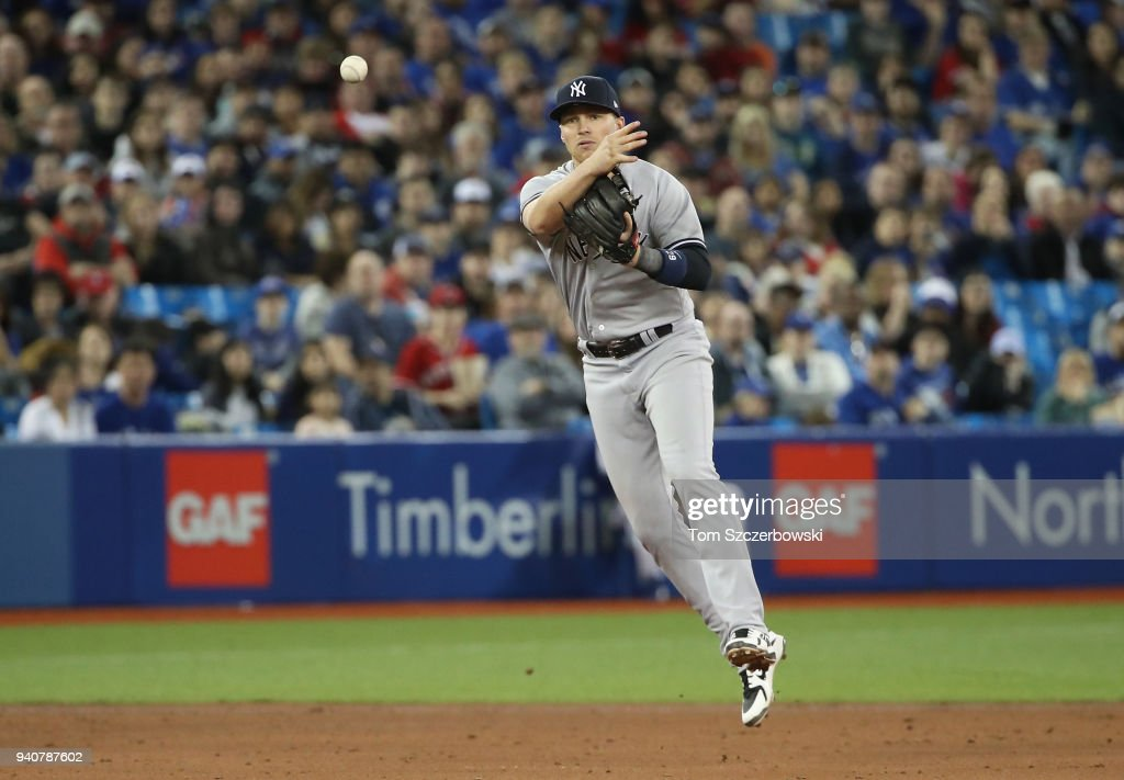 Brandon Drury #29 of the New York Yankees makes the play and throws out the baserunner in the fifth inning during MLB game action against the Toronto Blue Jays at Rogers Centre on April 1, 2018 in Toronto, Canada.