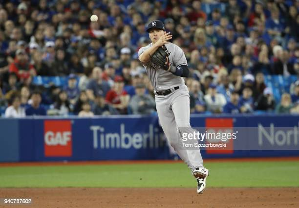 Brandon Drury of the New York Yankees makes the play and throws out the baserunner in the fifth inning during MLB game action against the Toronto...