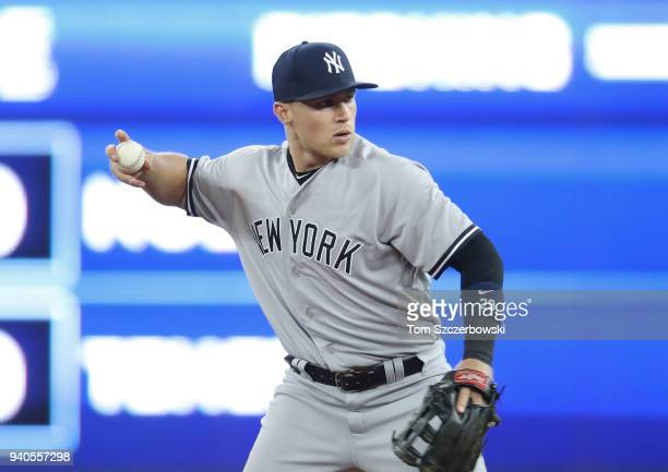 Brandon Drury of the New York Yankees warms up between innings on Opening Day during MLB game action against the Toronto Blue Jays at Rogers Centre...