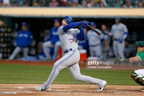 Brandon Drury of the Toronto Blue Jays at bat against the Oakland Athletics at Oakland-Alameda County Coliseum on April 19, 2019 in Oakland,...