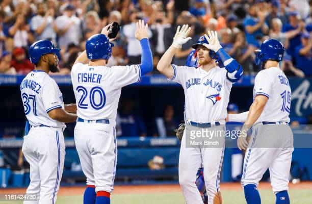 Brandon Drury of the Toronto Blue Jays celebrates his grand slam with teammates Teoscar Hernandez, Derek Fisher, and Randal Grichuk in the fourth...
