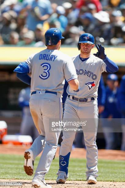 Brandon Drury of the Toronto Blue Jays celebrates with Billy McKinney after hitting a solo home run in the top of the fourth inning against the...
